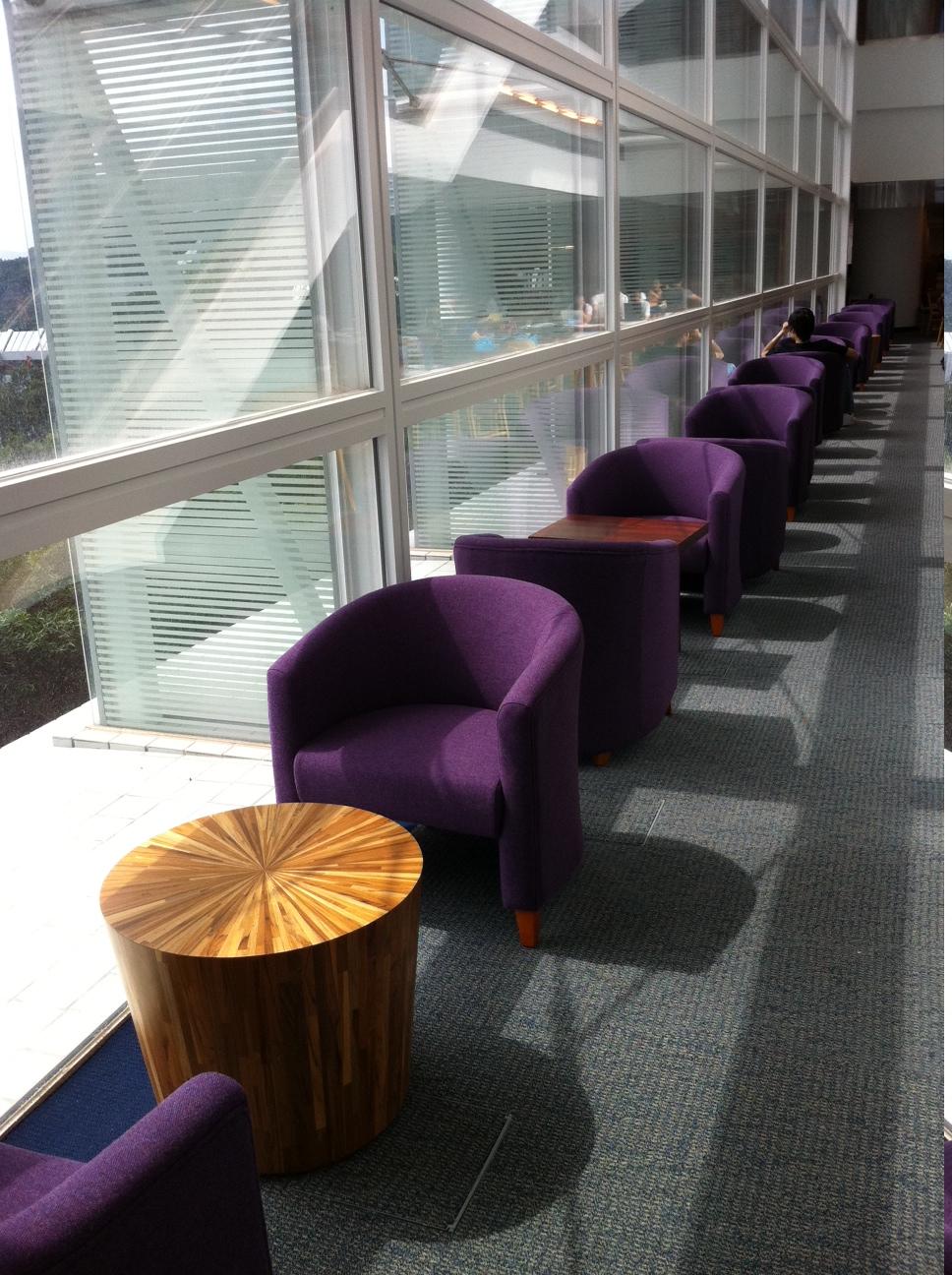 Sofa Chairs Along Window Wall